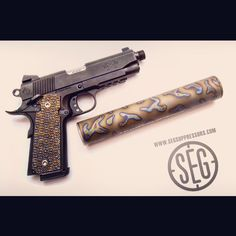 This American Tactical Imports FX45 1911 has custom #titanium grips to match our #seg #patented Blasted Camo finish on our titanium #Franklin #suppressor a great looking combo! Save those thumbs & bucks w/ free shipping on this magloader I purchased mine http://www.amazon.com/shops/raeind   No more leaving the last round out because it is too hard to get in. And you will load them faster and easier, to maximize your shooting enjoyment.