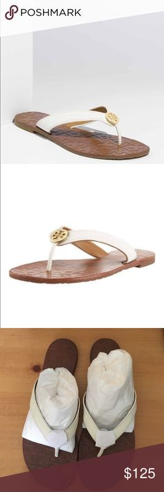 Tory Burch Thora Leather Sandal Tory Burch Thora Leather Sandals.  NWT.  Golden double T medallion adorns the center of tumbled leather thong strap. Logo-stamped insole. Effortless slide style; low-profile, packable design. .5 flat heel. Padded leather insole. Tory Burch Shoes Sandals