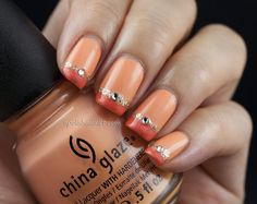 Peach, coral, & gold glitter mani (by A Polish Addict). Base color: two coats of China Glaze's Peachy Keen. Tips: Bourjois' Corail Magique (05), followed by a thin line of gold glitter using Tins' The Spicy Pinheel. Swarovski crystal in clear white (ss08) placed in middle. Seche Vite top coat.