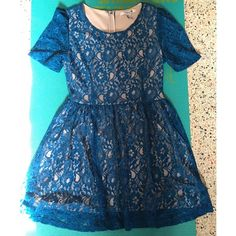 Forever 21 Lace Fit and Flare Dress Dress measures 34 inches long from shoulder to bottom hem. Waist measures 15.5 inches when laid flat. Sleeves are sheer lace. Tan colored lining. Worn one time for a photo shoot. No visible signs of wear. Back zipper closure. Forever 21 Dresses