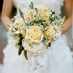 Creamy Rose Bouquet | Creamy fragrant roses, mixed with dusty miller and variegated foliage, make a fresh, cool color palette. | SouthernLiving.com