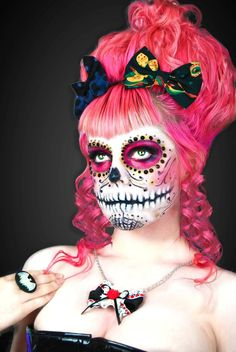 Pink Calavera. This makeup is so amazing, it's hard to distinguish there is an actual face behind it. The mouth was done perfectly.