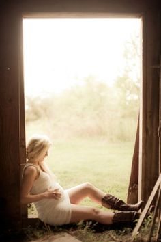 Maternity photo shoot - love the idea. Dress, boots, rustic setting. Tilt face up to elongate neck. Wrap arms around in a more loving way or leave them relaxed at sides.