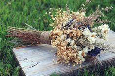 """wildflower fields bridal bouquet. dried lavender, ammobium, caspia, and perfecta baby's breath  hemp tied  measures 15"""" tall x 8"""" across"""