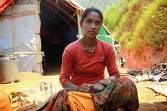"Somjana, 35, lives in a small village in Ghorka, one of the hardest-hit areas in Nepal. She and her husband made it through the earthquake but their house collapsed. They have now put together a tent with a tarp provided by #CARE. She also received a hygiene kit, some clothes and a water jar. She says, ""We don't know what to do. The plot where our house used to stand has huge cracks in it and there have been landslides."" Photo: Johanna Mitscherlich/CARE"