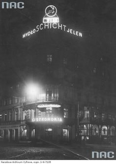 Warsaw 1935 by night Pictures Of Beautiful Places, Shooting Stars, Warsaw, Old Pictures, Poland, Hunting, Scenery, Advertising, Neon Signs