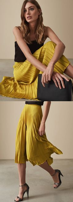2980539a7 Mustard Yellow Pleated Skirt. Calf-grazing lengths continue to steal the  spotlight in AW18