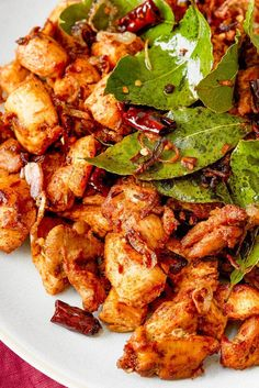 NYT Cooking: In the south Indian state of Kerala, a street stall selling food is called a thattukada, and one of the most well-known dishes served is something called chicken fry, or thattu chicken. The chef Asha Gomez, who grew up in the Kerala port city of Trivandrum and now lives in Atlanta, took that street chicken and adapted it into a quick-cooking recipe that relies on coconut oil for crispness, and ...