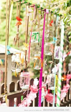 Whether for a backyard wedding or just to make your space more interesting for an outdoor party, hanging Mason jars filled with tea lights from colorful ribbons will add some whimsy. Hippie Party, Hanging Mason Jars, Hanging Candles, Deco Nature, Photo Booth Backdrop, Backdrop Ideas, Partys, Mason Jar Crafts, Tea Lights