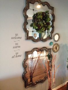 This is one of my favorite vignettes in my house. #decorating #mirror #living room