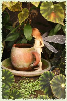 wendy froud~  a tea time fairy... adorable! would be fun to hide something like this in the garden for kids to find.