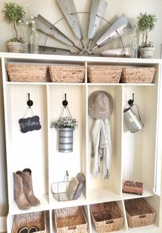 Windmill decor over cubbies! Farmhouse decor!  IG @bless_this_nest