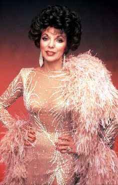 Joan Collins. Feathers and sparkles.