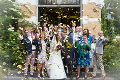 wedding picture of the group throwing confetti.  A little less confetti but still nice looking