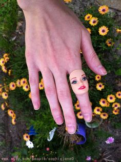 Seriously I need this in my life. Barbie head ring xx