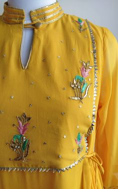 Fine resham thread hand work in golden Embroidered Yoke with gathered waistline and side tie-ups . Kurti Embroidery Design, Embroidery Fashion, Hand Work Embroidery, Stylish Dress Designs, Designs For Dresses, Kurta Designs Women, Blouse Designs, Churidar Designs, Yellow Skirt Outfits