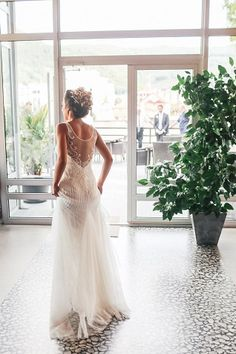 Summertime weddings are so romantic and soft. A beautiful wedding dress back that flows just like the winds of summertime. Beautiful light , romantic hairstyle, and an elegant lace wedding dress makes an absolutely great photograph.