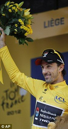 Go Spartacus!    Great start: Fabian Cancellara takes the overall leader's yellow jersey