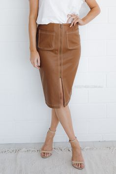 fit: standard sizing, fitted style, medium weight fabric, unlined, zipper in front to close, slit in front, front pockets colour: brown fabric: pu length: approx. 63cm from waist to hemline our model is 163cm tall and is pictured in a size 8/S