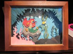 Disney Little Mermaid Ariel ORIGINAL ART Diorama Shadow Box Wall Hanging Display. So pretty :) Love to add this to my little mermaid collection. Disney Little Mermaids, Ariel The Little Mermaid, Disney Shadow Box, Seashell Shadow Boxes, Little Mermaid Bathroom, Little Mermaid Silhouette, Cricut Birthday Cards, Disney Cards, Disney Kunst