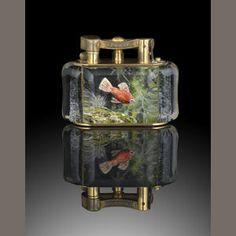 DUNHILL: An 'Aquarium' lighter Estimate: £1,500 - 2,500 €1,800 - 3,100 US$ 2,400 - 4,000