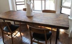 Reclaimed wood table. dont like how the ends are round though.