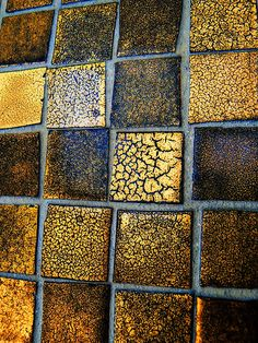 Tiles of gold.... Handmade tiles can be colour coordinated and customized re. shape, texture, pattern, etc. by ceramic design studios