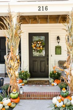 Cozy traditional fall porch decorated with corn stalks, orange, green and white pumpkins, orange mums, Fall Home Decor, Autumn Home, Traditional Porch, Fall Planters, Garden Planters, Halloween Porch, Cheap Halloween, Fall Halloween, Pumpkin Lights