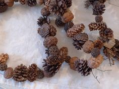 I want to make one of these natural garlands.  Instead of making the silver wreath with my sweet gum balls that I have collected, perhaps I should keep it natural and make one of these instead.
