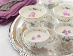 Creamy Coconut–Vanilla Bean Panna Cotta, served in vintage teacups, are a great make-ahead dessert for teatime.