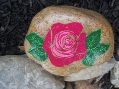 Here is a rock I painted for my mom, she loves roses! So I tried.....anyhew, flowers are hard. But I will keep trying!