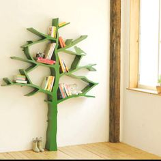 Bookshelf tree! I would paint the tree tan/beige and pull in the accent colors as needed. Cute way to store and display books - and Al can totally make this!