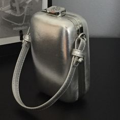 Tory Burch metallic silver minaudière Used 1X for a wedding...so elegant and fits essentials perfectly...MINOR scuffing on the leather (as seen in photos, so it does not take away from the piece in any way)...$115 on Ⓜ️ercri!!! Tory Burch Bags Clutches & Wristlets