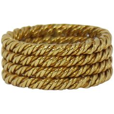 Tiffany Four Row Twisted Rope Gold Band | From a unique collection of vintage band rings at https://www.1stdibs.com/jewelry/rings/band-rings/