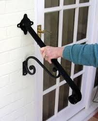 WROUGHT IRON HANDRAIL For the side of door with one or two steps Just bolt to the brickwork with the supplied bolts and drill Stands out from wall Wrought Iron Stair Railing, Iron Staircase, Wrought Iron Beds, Wrought Iron Decor, Stair Handrail, Wrought Iron Fences, Hand Railing, Porch Handrails, Exterior Handrail
