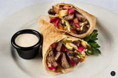 ~ Lamb Shawarma Sandwich ~ Toppings include tahini, garlic and vegetables. Pita Wrap, Lebanese Recipes, Shawarma, Vegetarian Options, Falafel, Tahini, Hummus, Lamb, Grilling