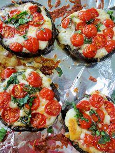 caprese style  portobellos | large portobello mushroom caps, gills removed, cherry tomatoes, halved, shredded or fresh mozzarella, fresh basil, olive oil.