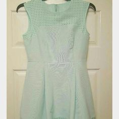 "Jcrew perforated dress sea foam green sz.8petite Stunning dress by J. Crew, size8 Petite The ""Perforated A Line Dress""? 76% Cotton/24% Silk Exclusive of Trim Black#c0508 Fully lined, Side Seam Pockets and Rear zip closure ""Perforated laser-cut details punch up this flirty A-line dress, which boasts an almost universally flattering fit, making it a fun and easy springtime go-to. Picnic in the park, anyone?"" ~ J Crew.Cotton/silk, with poly/elastane chest and trim.Back zip.On-seam pockets.Poly…"