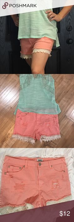 Coral and lace shorts Coral denim shorts with cream lace accent and distressing. Can dress up or down easily with the the right tans and heels or sandals. celebrity pink jeans Shorts Jean Shorts