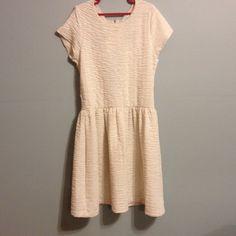 MINI DRESS Cream colored short sleeved mini dress with sparkles/glitter. Strappy back. Short & tight fitting. Size medium. Never worn. Kimchi Blue Dresses Mini