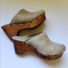 """Cordani Calzature Nougat Cow Hair Clogs 39 NIB. Comfort & perfect boho styling. Stunning bohemian cow hair studded clogs by Cordani. Perfect easy slip-on wear. Studded accents, lightly cushioned textile footbed for added comfort.  Molded heel and platform. Synthetic sole. Heel Height: 3 1⁄2"""" Platform Height: 1 1⁄4"""" Cordani Shoes Mules & Clogs"""
