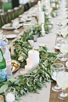 Green Garlands and Candles | Design: Viva Bella Events | Photography: Stacy Newgent | Read More:  http://www.insideweddings.com/weddings/rustic-barn-wedding-tented-reception-on-family-farm-in-ohio/690/