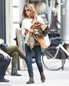 #Blundstones  Autumn chic: The Felicity star donned a cream cable knit sweater, dark skinnies and brown boots