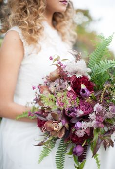 Organic and natural bouquet of ferns, orchids, astrantia, carnations and peonies