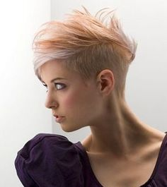 Short funky hair with shaved side. Love it!