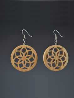 Mark Noll original design, Infinity Flower Pallet dangle earrings. These lightweight earrings are made from upcycled Pallet wood or other discarded wood. The wood is usually oak, but it might vary. Th