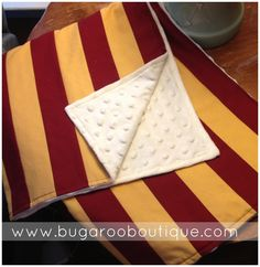 Gryffindor inspired baby quilt. Harry Potter Baby Gift // Handmade blanket with maroon and golden stripes backed in cream minky dot.