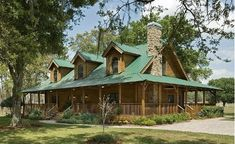 beautiful log home : )  love everything esp the porch !
