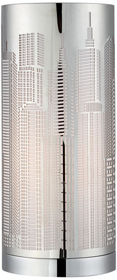 """Laser Cut Skyline Cylinder Accent Lamp  Style  Bring the bright city lights indoors with the Skyline accent lamp.  $49.99 This cylinder accent lamp features an interesting and eye-catching laser cut skyline design. Light shines through the buildings like it would through a skyscrapers windows. Place this elaborate design on an accent or end table as a shining decorative piece.  Laser cut skyline design. Takes one 25 watt bulb (not included). 13"""" high. 5 1/2"""" diameter."""