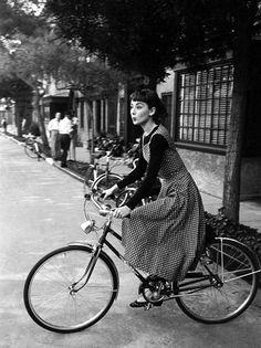 Beautiful Audrey Hepburn riding a bike